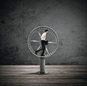 success trap--man on a hamster wheel
